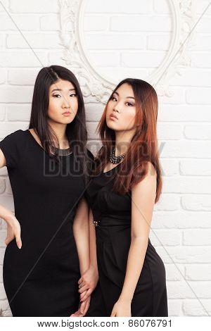 Two Beautiful Women In Black Gowns