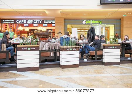 RUSSIA, MOSCOW - MARCH 19, 2015: Shopping center Afimall City people sit in cafes