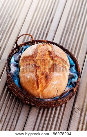 loaf of homemade bread in the basket - food and drink