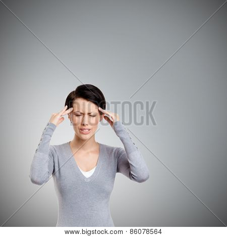 Upset girl tries to solve problems, isolated on grey