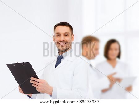 medicine, profession, and healthcare concept - smiling male doctor with clipboard writing prescription over white background