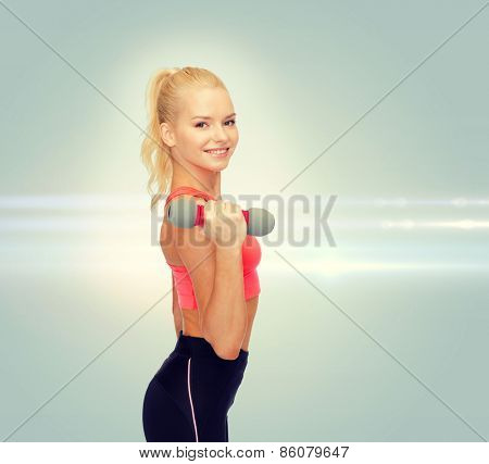 fitness, sport and diet concept - smiling beautiful sporty woman with dumbbell