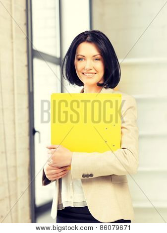 bright picture of beautiful woman with folder