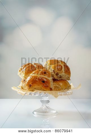 Display of Hot Cross buns on glass cake stand
