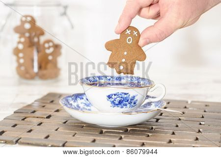 Funny gingerbread man with no legs after being dipped into hot tea
