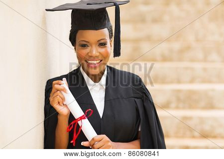 portrait of african female graduate standing outdoors