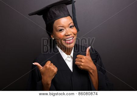 close up portrait of african female university graduate thumbs up