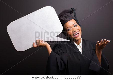 gorgeous african female university graduate holding speech bubble