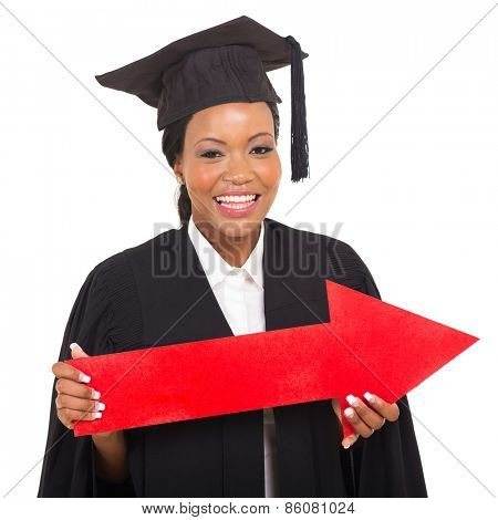 african american female graduate holding big direction arrow on white background