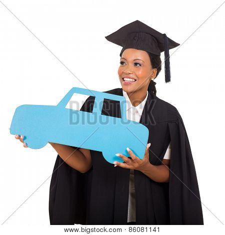 gorgeous african american female graduate holding a car symbol on white background