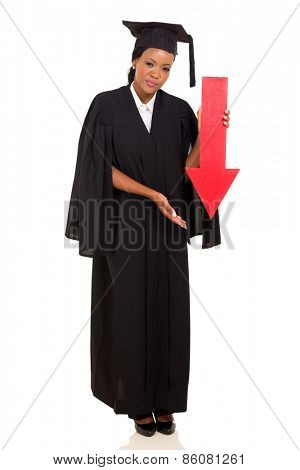 female african college graduate holding red arrow pointing down