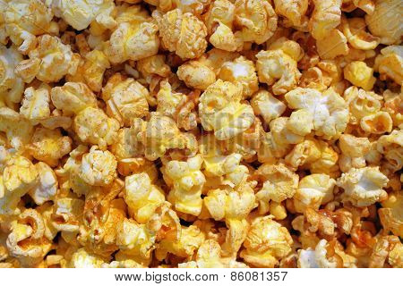 Tasty popcorn closeup background