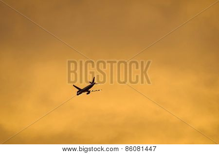 An airliner flying in the evening light