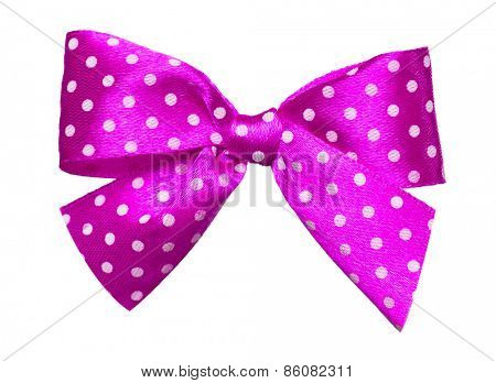 pink bow with white polka dots made from silk isolated