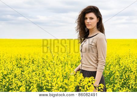 girl portrait in yellow flower field