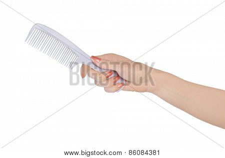 Isolated woman hand holding hair comb