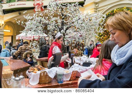 Moscow - March 22: A Buyer Choosing A Baking In The Gum Store On March 22, 2015 In Moscow. Gum Is Th
