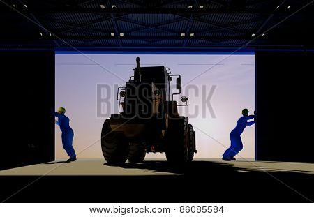 Silhouettes of a tractor and workings in the hangar.