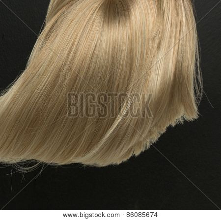 Blond hair isolated on black