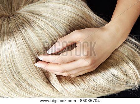 Hand on blond hair