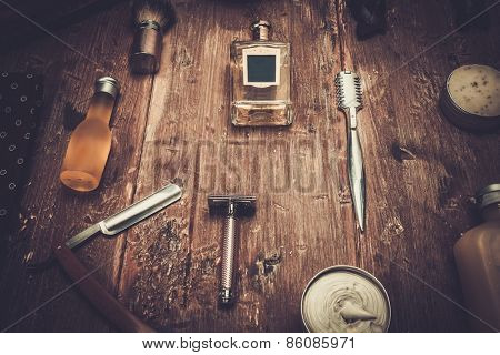 Gentleman's accessories on a on a luxury wooden board