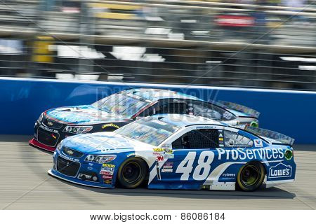 Fontana, CA - Mar 22, 2015:  Jimmie Johnson (48) brings his race car down the front stretch during the Auto Club 400 race at the Auto Club Speedway in Fontana, CA.