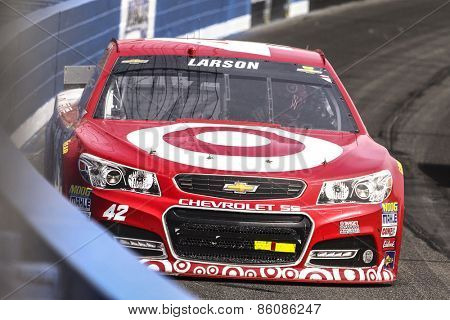 Fontana, CA - Mar 22, 2015:  Kyle Larson (42) brings his race car through the turns during the  race at the Auto Club Speedway in Fontana, CA.
