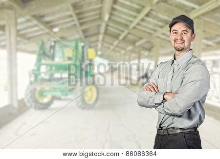 smiling farmer portrait and farm background