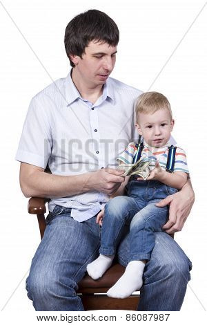 Father giving his son money