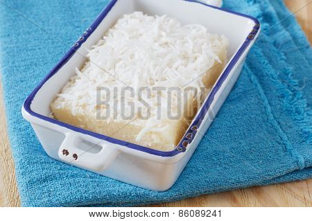 Sweet Couscous  Pudding With Coconut On Plate On Blue Towel