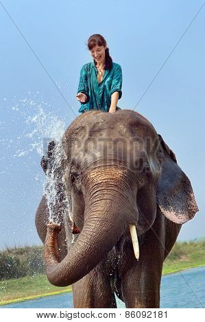 Beautiful Girl Is Having A Shower With The Elephant.