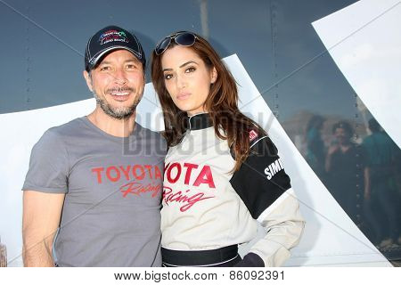 LOS ANGELES - FEB 21:  Raul Mendez, Donna Feldman at the Grand Prix of Long Beach Pro/Celebrity Race Training at the Willow Springs International Raceway on March 21, 2015 in Rosamond, CA