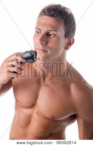 Muscular Man Shirtless Using Electric Shaver, Looking Away