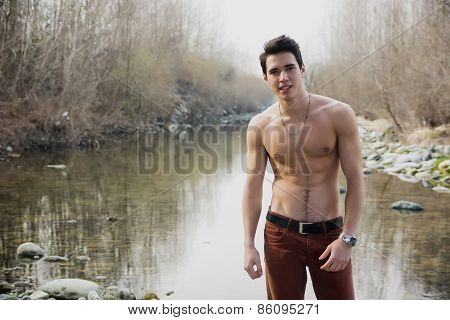 Athletic Shirtless Young Man Outdoor At River Or Water Pond