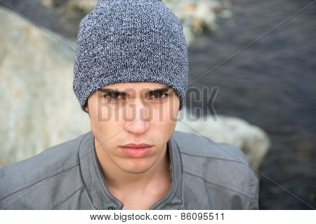 Headshot Of Attractive Young Man Outdoor Wearing Wool Hat