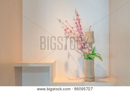 Bamboo Vase With Cherry Blossom On A Shelf