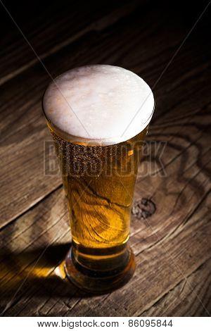 Mug Of Beer On Wooden Background