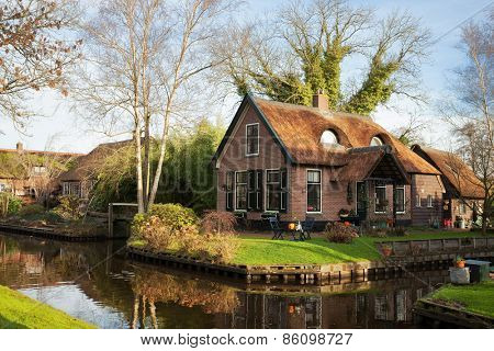Old house with  thatched roof  in Giethoorn, Netherlands.