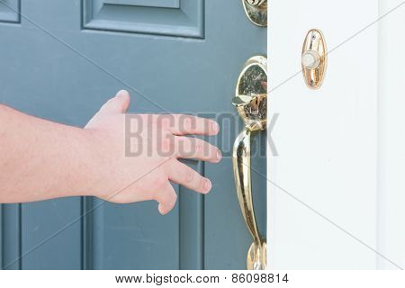 Man's Hand About To Open Front Door