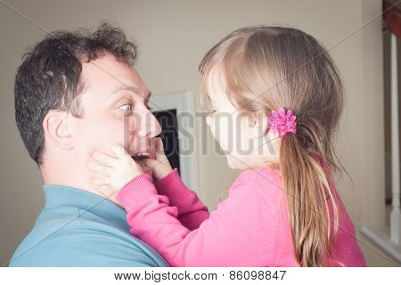 Little Girl Being Playing With Her Dad