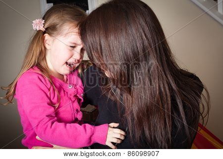 Crying Little Girl Being Comforted By Her Mother