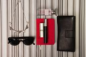 foto of perfume  - Sunglasses necklace purse and a bottle of perfumes - JPG