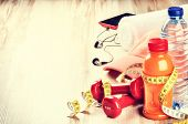 foto of sportswear  - Fitness concept with dumbbells fruits juice water and sportswear - JPG