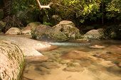 picture of crystal clear  - Malaysia.Tioman island summer.Mountain stream with crystal-clear water and giant rocks.