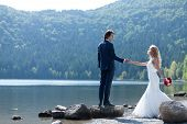 pic of she-male  - Beautiful married couple acting very romantic near a lake - JPG
