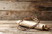 image of thorns  - Crown of thorns and scroll on old wooden background - JPG