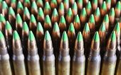 picture of cartridge  - Big group of rifle cartridges that have bullets with green tips - JPG