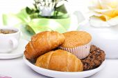 stock photo of continental food  - continental breakfast with croissants cake chocolate cookies and tea - JPG