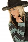 image of cowgirls  - a woman in her poncho wearing her cowgirl hat looking down to the side - JPG