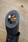 pic of butts  - Ashtray soiled with cigarette butts in the street - JPG